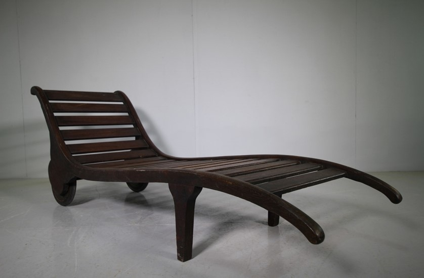 Heals antique teak lounger.