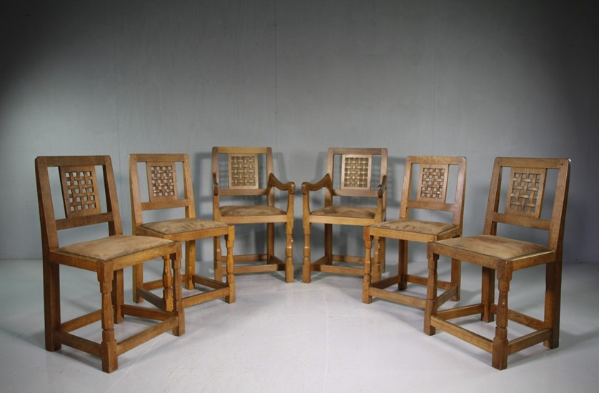 20th Century dining chairs with carved back