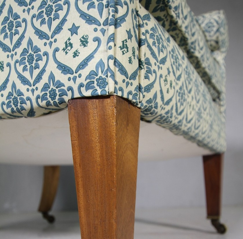 Close up of upholstered chair showing detail