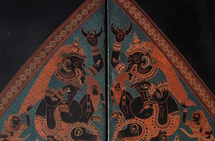Close up detail of a Burmese lacquered engraved panel