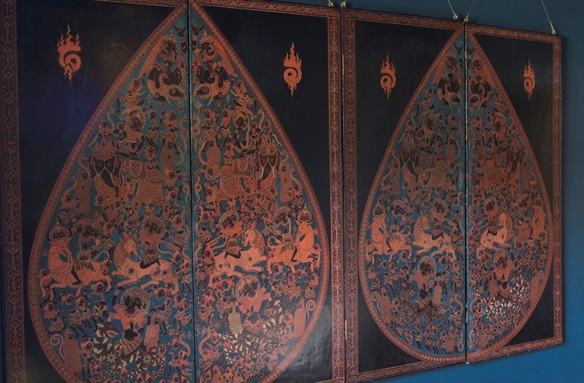 A large Burmese lacquered engraving over four panels